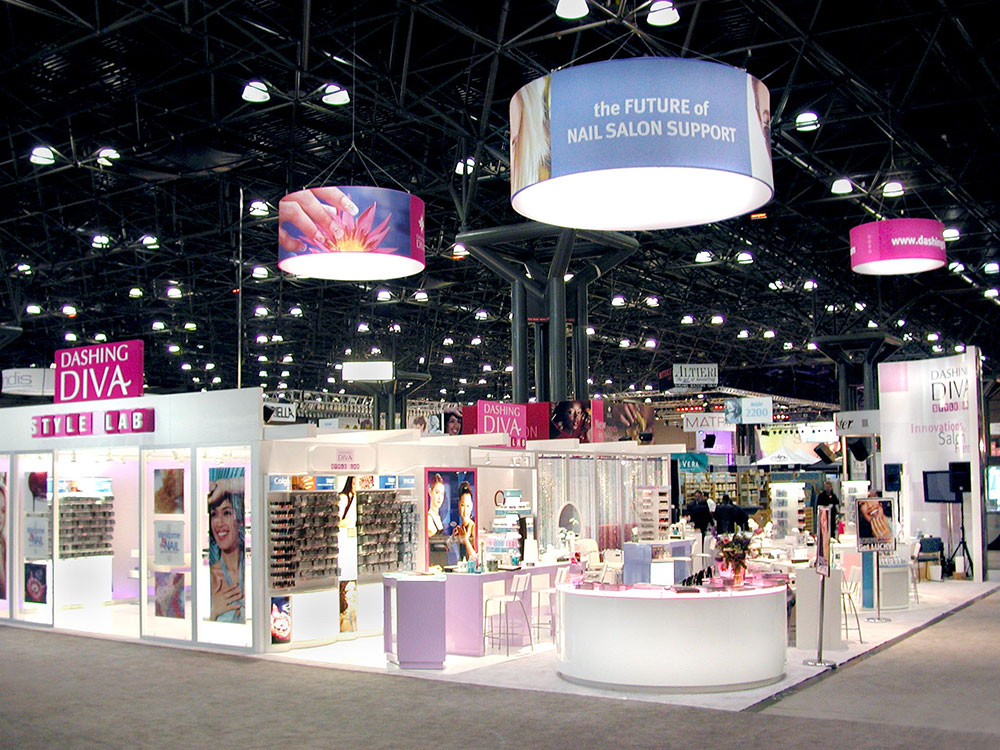 trade show booth design for CosmoProf North America features product merchandising and modular workstation system and retail store prototype