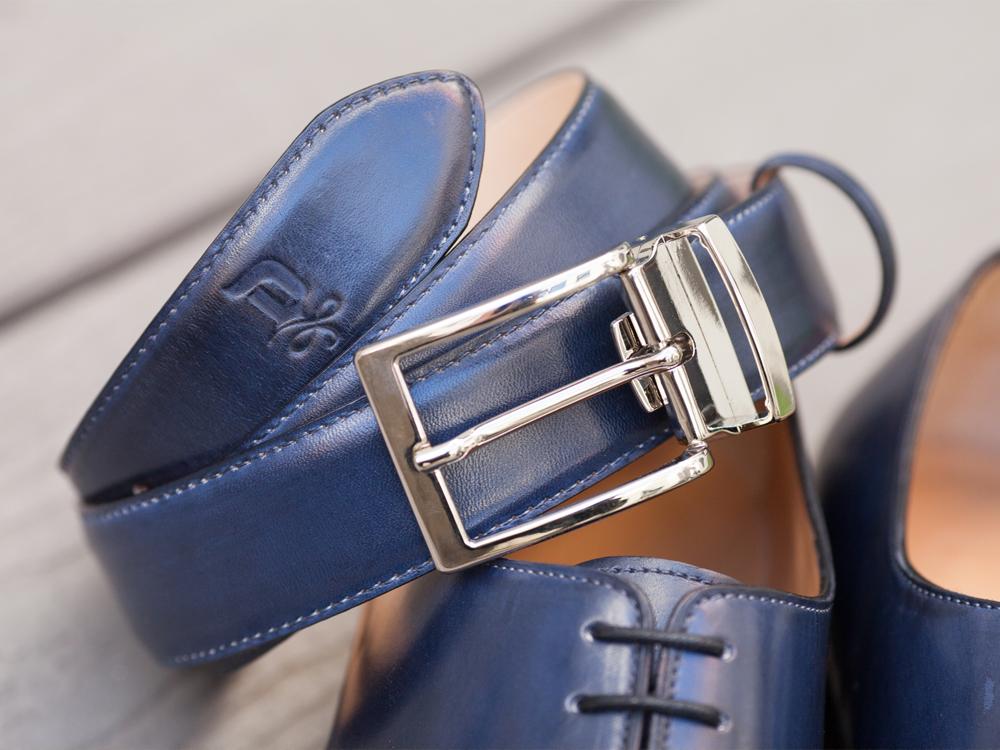 Distinctive DONUM branding elements translate to product markings, footwear soles and belt details