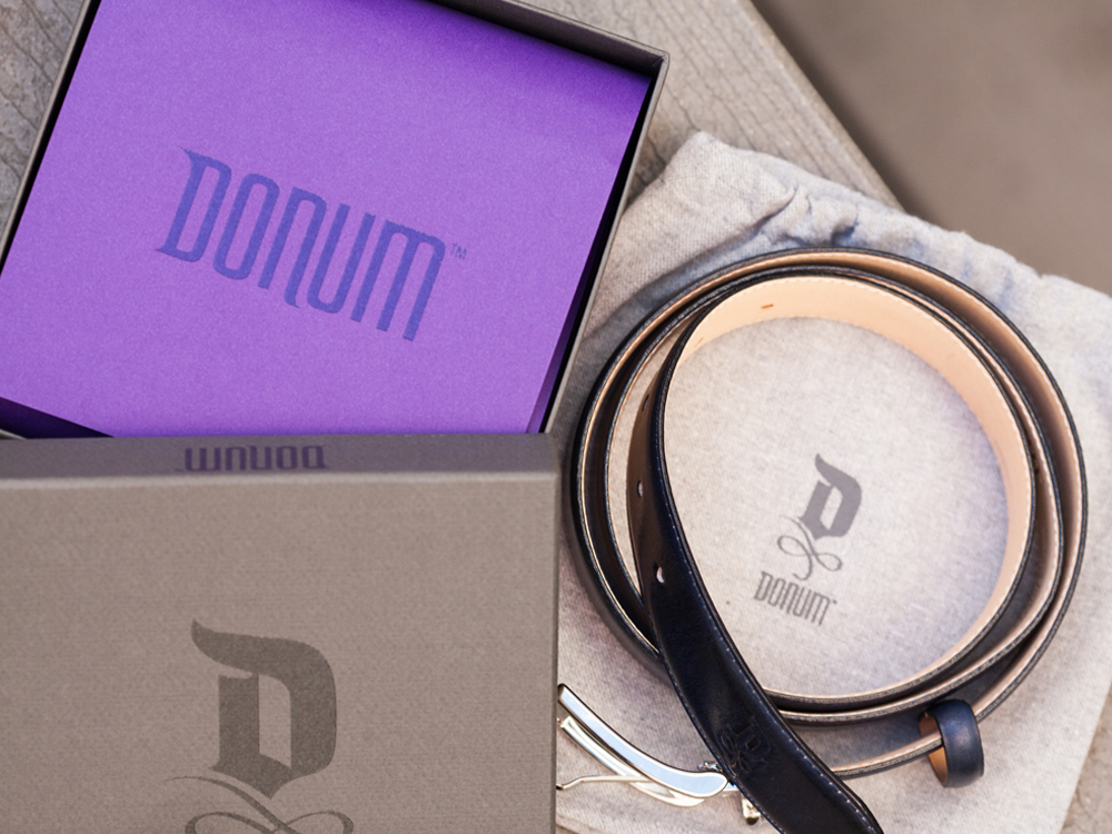 Distinctive DONUM branding elements translate to product markings, footwear soles and belt details